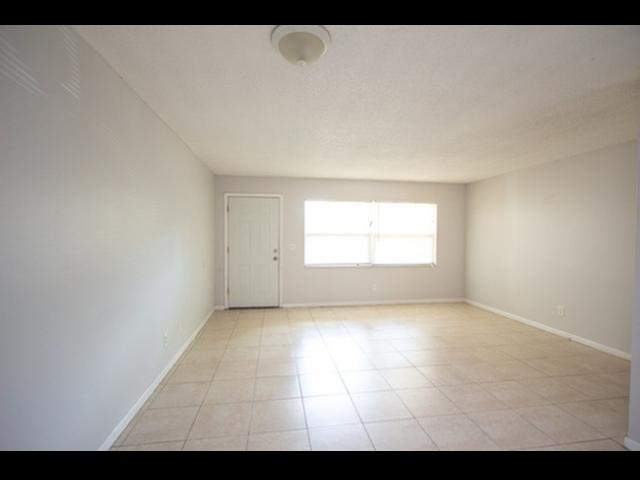 Living Room with tile floor-door